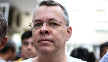U.S. pastor Andrew Brunson escorted by Turkish plain clothes police officers arrives at his house in Izmir, July 25, 2018.