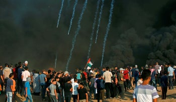 Palestinian protesters gather at the Israel-Gaza border, east of Gaza city, on October 12, 2018.
