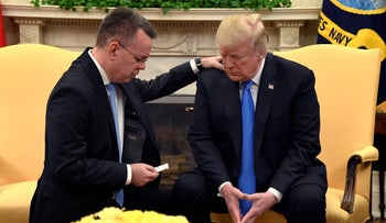 U.S. President Donald Trump with Pastor Andrew Brunson in the Oval Office of the White House, Washington, U.S., October 13, 2018