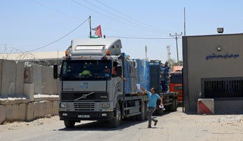 Trucks full of goods arriving from Israel depart from the Palestinian side of the Kerem Shalom cargo crossing, in Rafah, southern Gaza Strip, Aug. 15, 2018.