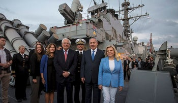Israeli Prime Minister Benjamin Netanyahu and his wife Sara tour together with U.S. Ambassador to Israel David Friedman, USS Ross, during a ceremony marking the 243rd anniversary of the American Navy aboard the guided-missile destroyer,  at the Ashdod port, Israel October 11, 2018