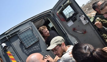 Avner Gvaryahu, executive director of Breaking the Silence, is detained during a tour by his anti-occupation organization, Hebron area, West Bank, August 31, 2018.