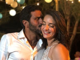 Lucy Aharish and Tzachi Halevy pose for a photo at their wedding party in Hadera, October 11, 2018.