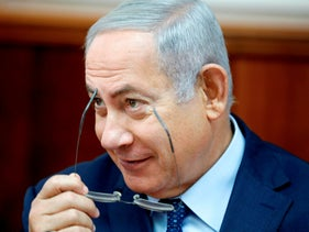 Israeli Prime Minister Benjamin Netanyahu attends the weekly cabinet meeting at the Prime Minister's office in Jerusalem on October 14, 2018