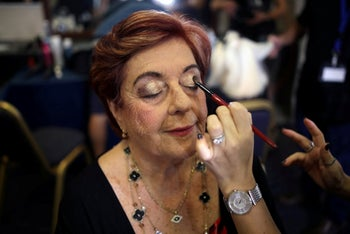 Holocaust survivor Madeleine Schwartz, 74, gets make up before the beginning of the annual Holocaust survivors' beauty pageant in Haifa, Israel, October 14, 2018.