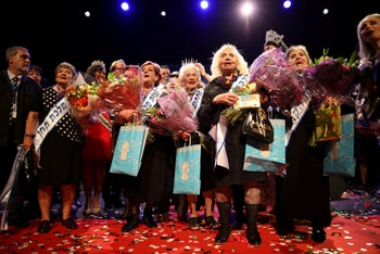Holocaust survivors take part in the annual Holocaust survivors' beauty pageant in Haifa, Israel, October 14, 2018.