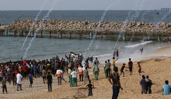 Palestinian protesters gather during a demonstration on the beach near the maritime border with Israel in the northern Gaza Strip, October 15, 2018.