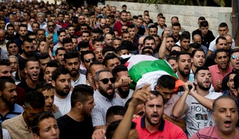 Palestinians carry the body of Aisha Rabi during her funeral in the West Bank village of Biddya, October 13, 2018.