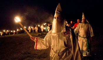 FILE PHOTO: Members of the Ku Klux Klan participate in cross burnings after a rally in rural Paulding County, Georgia, April 23, 2016.