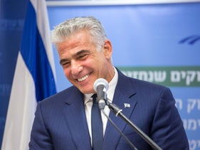 Yair Lapid at a meeting with Knesset members from his Yesh Atid party, October 15, 2018.