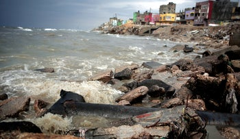 FILE PHOTO: Sewage flows from an outlet into the sea in front of Shati refugee camp in Gaza City, April 12, 2016