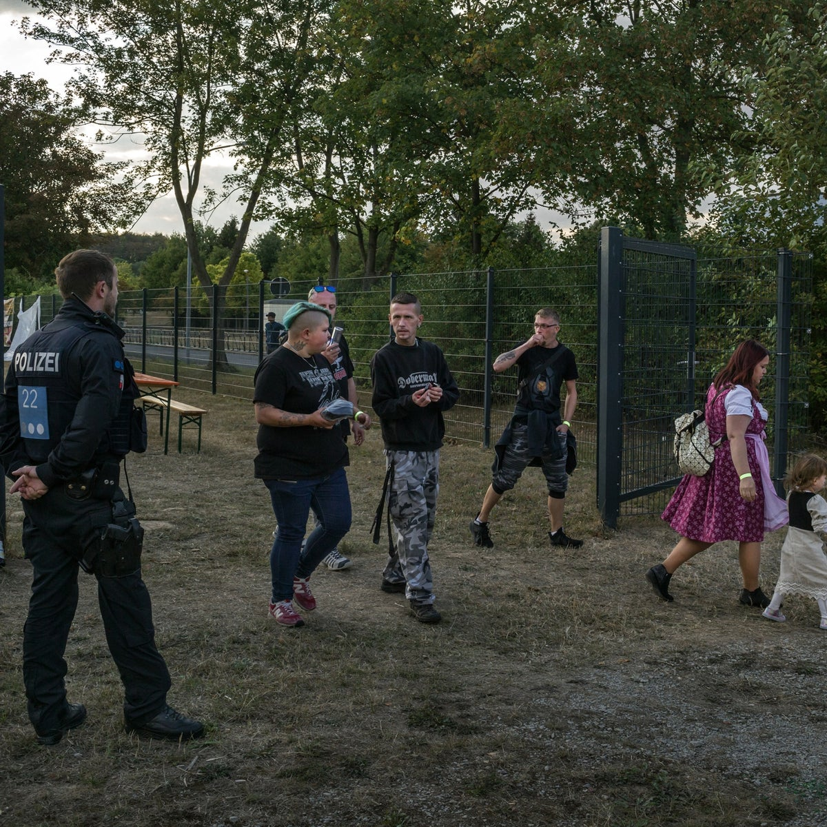Watched by a police officer, participants leave the eighth annual Eichsfeld Day, organized by the National Democratic Party, a political party of avowed neo-Nazis, in Leinefelde, Germany, Sept. 1, 2018. German right-wing extremists are holding open-air events, mostly rock concerts, in small towns throughout the country as a way to spread their message, recruit supporters and show their power. (Mauricio Lima/The New York Times) פסטיבל NDP בגרמניה . מגיעים עם ילדים