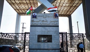 Palestinian and Egyptian flags wave over two photos of Palestinian President, Mahmoud Abbas, and Egypt's President Abdel-Fattah al-Sissi hanging on the main gate of the Rafah crossing border with Egypt, in the Southern Gaza Strip,Wednesday, Nov. 1, 2017.