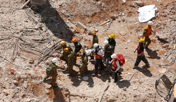 An injured construction worker evacuated from the wreckage in Tel Aviv.