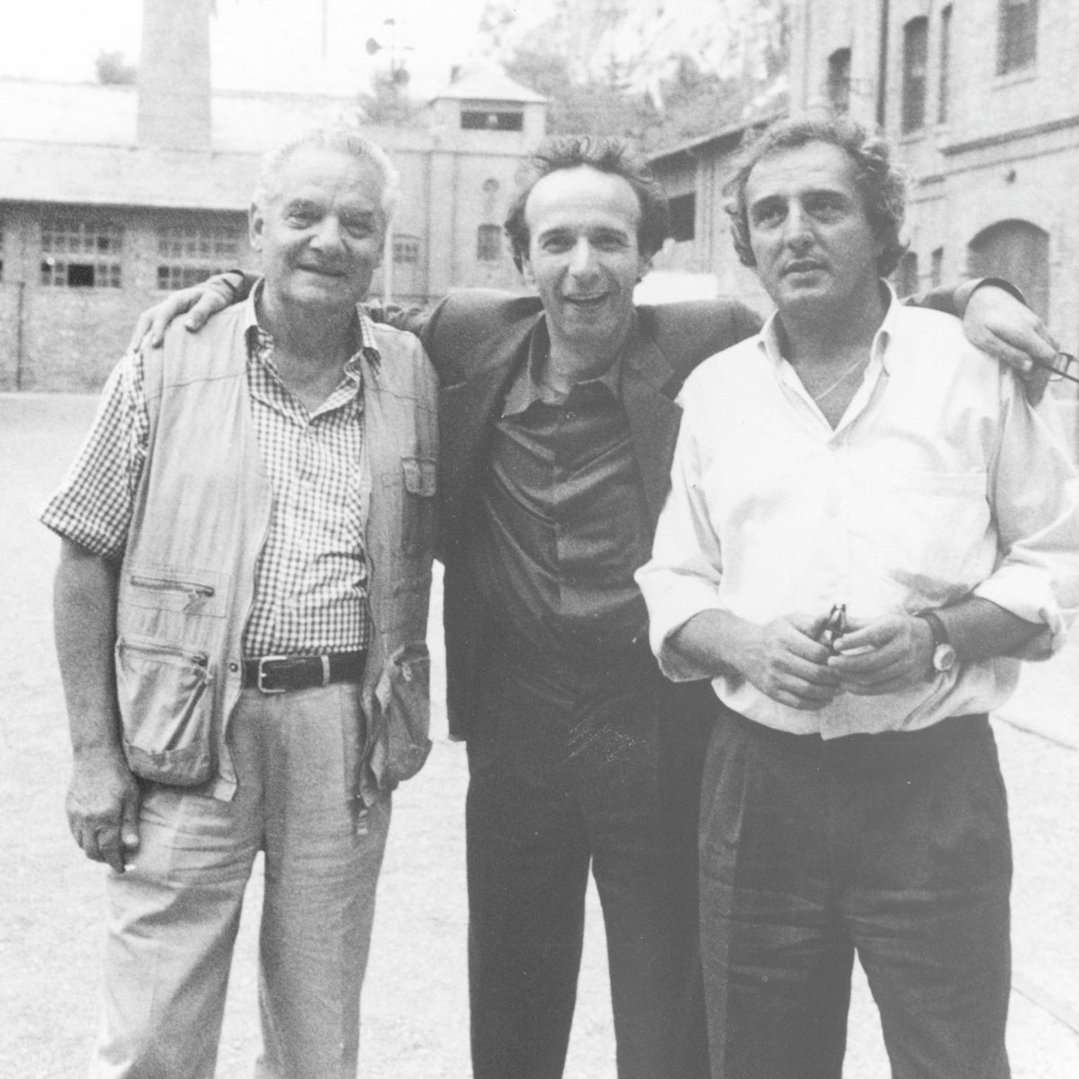 """Holocaust consultant Marcello Pezzetti, left, on the set of """"Life is Beautiful"""" with director Roberto Benigni and Holocaust survivor Shlomo Venezia, who visited Auschwitz with Pezzetti 57 times."""
