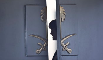 Consulate staff seen behind the entrance of the Saudi Arabia's Consulate in Istanbul. Oct. 17, 2018
