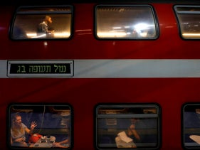 Commuters are seen on the new high speed train travelling between Jerusalem and Israel's Ben Gurion International Airport, on September 25, 2018, in Jerusalem.
