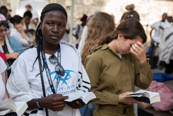 Birthright participants from Uganda attend a prayer at the mixed-gender prayer area at the Western Wall in Jerusalem. 27 August 2018