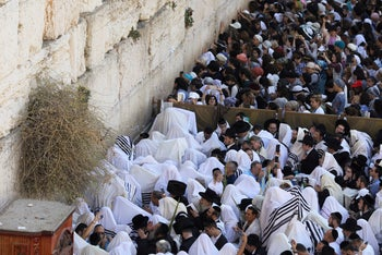 Male and female Jewish worshippers take part in a priestly blessing held on the Jewish holiday of Sukkot at the Western Wall in Jerusalem's Old City September 26, 2018