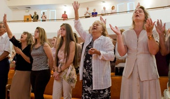 """Parishioners at Sunday services at the Bethel Assembly of God church in Lake Worth, Florida. During the Bush era many evangelicals supported the Republican party for its strong stand on """"family value"""" issues such as abortion and gay marriage. But, in 2008, the Obama campaign had success in winning back Christian voters, especially younger ones, who believed that war, economic inequality and environmental stewardship are important moral issues, along with traditional """"family values"""". """" (Photo by robert wallis/Corbis via Getty Images)"""