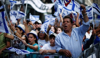 Pro-Israel supporters shout slogans during a rally at Times Square in New York, to show support for Israel's military offensive in the Gaza Strip, July 20, 2014.