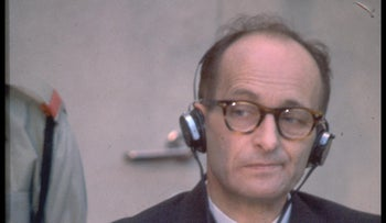Nazi war criminal Adolph Eichmann, who lived in Argentina after WW2 until he was captured by Israel, in his bullet- proof cell during his trial in Bet Ha'am, Jerusalem, 1961