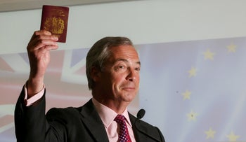 "Nigel Farage, leader of the U.K. Independence Party (UKIP), holds up his passport as he speaks in front of a backdrop of a British Union flag, also known as a Union Jack, and a EU flag, during a news conference for the EU referendum ""Leave"" campaign in London, U.K., June 22, 2016."