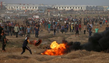 Palestinians protesting near the Gaza-Israel border fence, October 19, 2018.