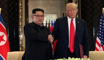 U.S. President Donald Trump shakes hands with North Korea's leader Kim Jong Un  after their summit in Singapore June 12, 2018.