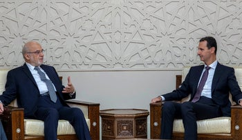 In this photo released by SANA, Syrian President Bashar Assad, right, meets with Iraqi Foreign Minister Ibrahim al-Jaafari, in Damascus,  October 15, 2018.