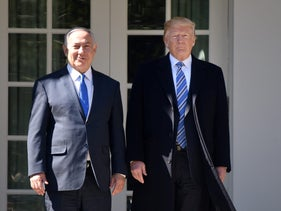 U.S. President Donald Trump, and Prime Minister Benjamin Netanyahu stand outside the White House, March 5, 2018.