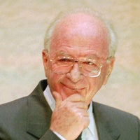 Yitzhak Rabin grins at hecklers who interrupted his speech during a Knesset debate in Jerusalem, October 5, 1995