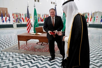 U.S. Secretary of State Mike Pompeo receives a gift during his visit to Riyadh, Saudi Arabia, on Tuesday, October 16, 2018