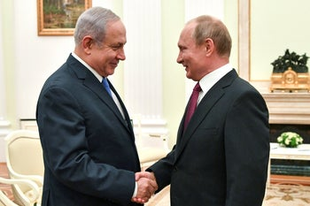 Netanyahu with Putin in Moscow, July.