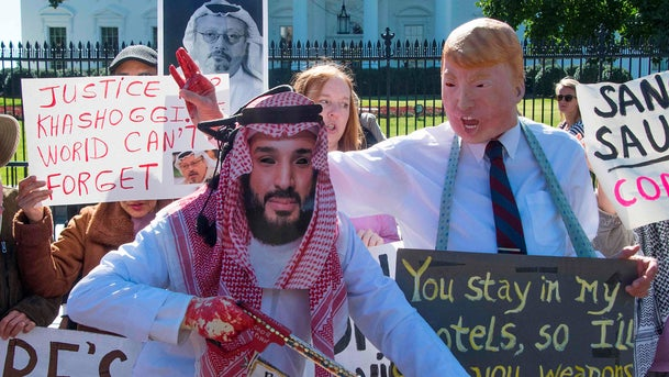 Demonstrators dressed as Crown Prince Mohammed bin Salman and President Donald Trump protest outside the White House, October 19, 2018.