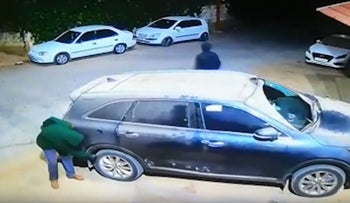 Security footage of assailants slashing tires of cars in West Bank village of Marda.