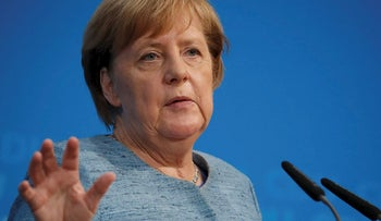German Chancellor Angela Merkel addresses a press conference in Berlin on October 21, 2018 ahead of next weekend's regional elections in the west German state of Hesse