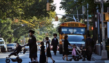 "An Orthodox Jewish community in the Borough Park section of New York's Brooklyn. """"I feel safe in New York City""."