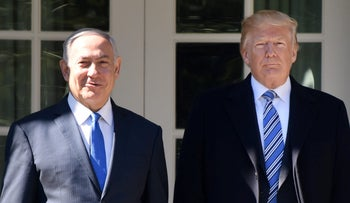 U.S. President Donald Trump, right, and Benjamin Netanyahu, Israel's prime minister, stand for photographs outside the White House in Washington, D.C., U.S. March 5, 2018