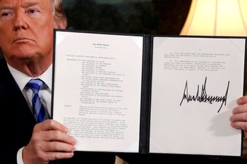 U.S. President Donald Trump holds up a proclamation declaring his intention to withdraw from the JCPOA Iran nuclear agreement. Washington, D.C. May 8, 2018