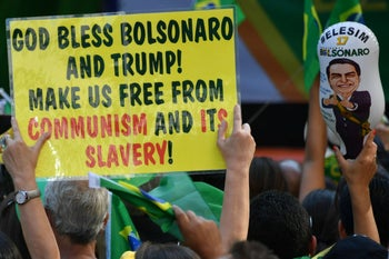 Supporters of Brazilian right-wing presidential candidate Jair Bolsonaro take part in a rally along Paulista Avenue in Sao Paulo Brazil on October 21 2018