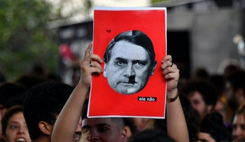 Demonstrators take part in a protest against Brazilian right-wing presidential candidate Jair Bolsonaro in Sao Paulo, Brazil, on October 20, 2018