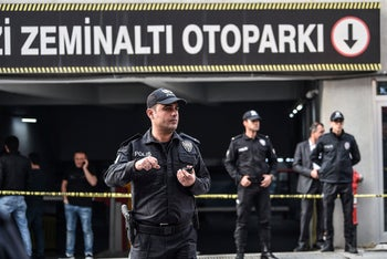 Turkish police officers stand guard as they cordon off the area around an underground car park on October 22, 2018