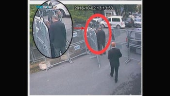 This image from a CCTV video purportedly shows Saudi dissident Jamal Khashoggi talking to his fiancee Hatice Cengiz, seen in expanded view, before entering the consulate in Istanbul, on Oct. 2, 2018