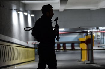 A Turkish police officer stands guard at the entrance of the cordoned off underground car park after a suspicious Saudi diplomatic vehicle was identified, on October 22, 2018