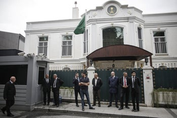 Consular security personnel await for the arrival of forensic investigators outside the Saudi Arabian consulate in Istanbul, Turkey, on Wednesday, Oct. 17, 2018