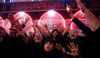 Shi'ite pilgrims gather ahead of Ashura, the holiest day on the Shi'ite Muslim calendar, in Kerbala, Iraq, Sept. 19, 2018.