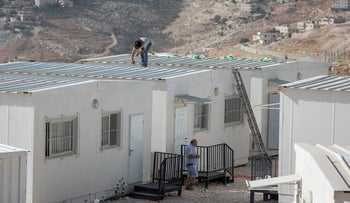 Personnel from the Defense Ministry and the IDF's Civil Administration dismantling temporary structures in the West Bank village of Azzariyeh, October 23, 2018.