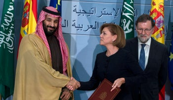Saudi Arabia Crown Prince Mohammed bin Salman and Spain's then Defense Minister Maria Dolores Cospedal shake hands after signing bi-lateral agreements, April 12, 2018.