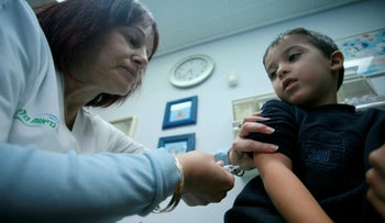An Israeli kid receiving a vaccine in the Israeli city of Lod
